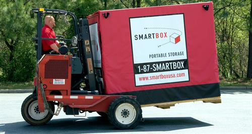 man carrying smartbox on forklift