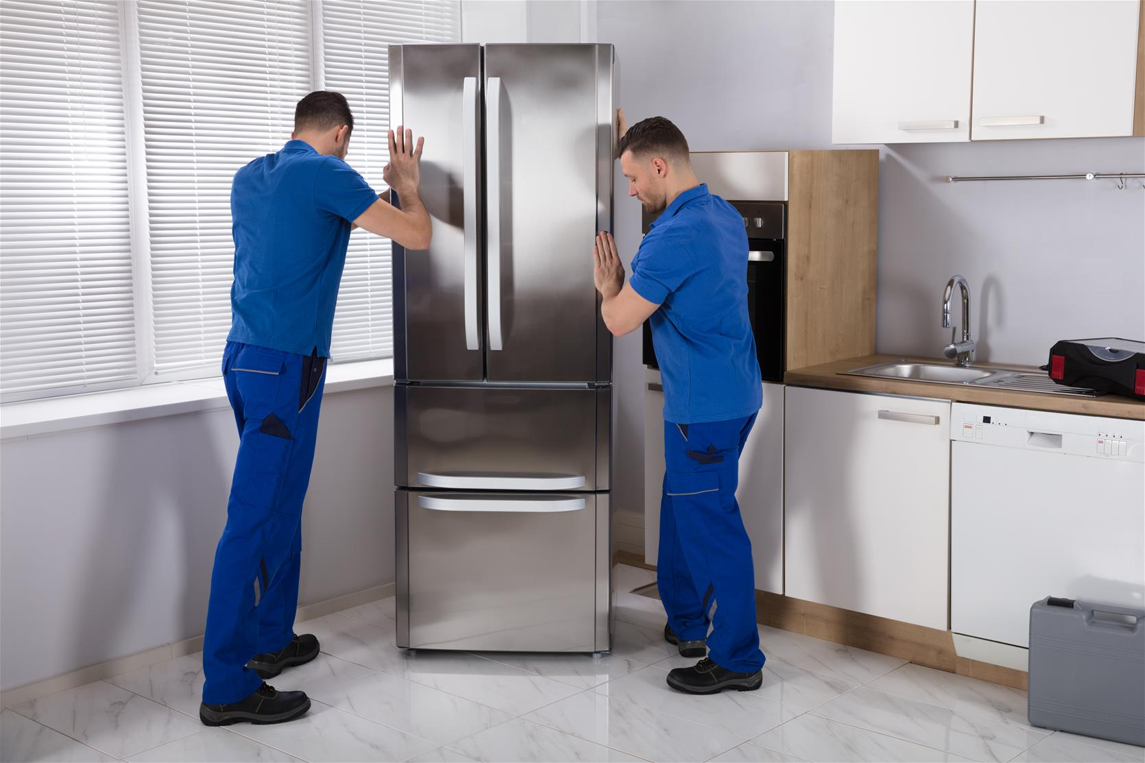 Men moving Refrigerator