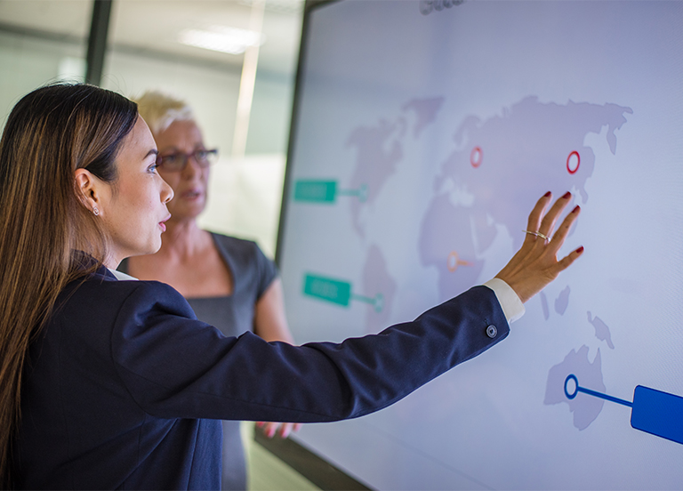 Women looking at map of a country